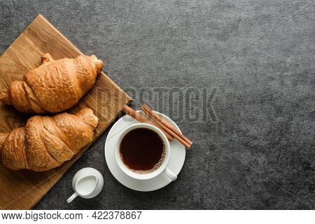 Coffee And Croissants On A Rough Background With Copy Space. Flat Lay Composition With A Cup Of Coff