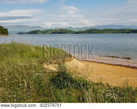 Douglas Lake In The Spring In Tennessee With The Great Smoky Mountains In The Background, The Water