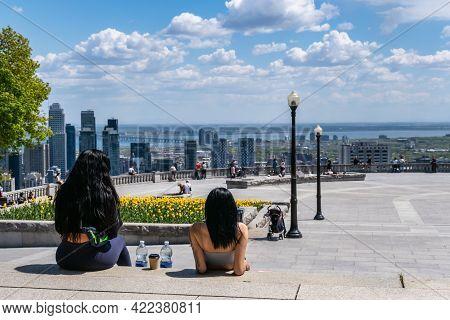 Montreal, Ca - 14 May 2021: People Enjoying View Of Montreal Skyline From Kondiaronk Belvedere Locat
