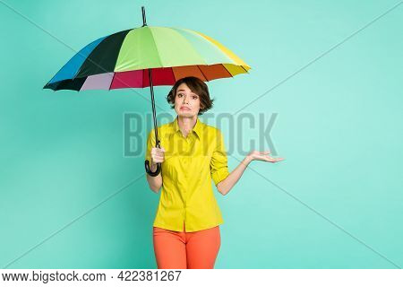 Photo Portrait Of Sad Grumpy Woman Keeping Umbrella In Rainy Weather Isolated On Vibrant Turquoise C