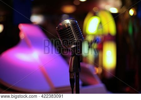Vintage Microphone - Pictures Of An Vintage Microphone And Piano In A Club