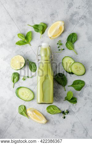 Detox Drink In Glass Bottle With Fresh Fruits And Vegetable Ingredients. Spinach Smoothie, Healthy C
