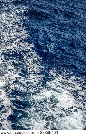 Water Splashed Use For Graphic Design. Texture Dark Blue Sea And White Foam Top View. Blue Sea Textu