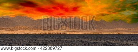 Coast Of The Red Sea With The Sinai Mountains In Egypt. Bible Landscape - Sinai And Red Sea. Sunset