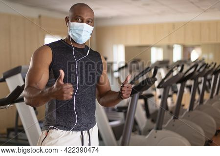 Portrait Of Black Male Sportsman With Face Mask. He Is Inside The Gym In A Positive Attitude. Concep