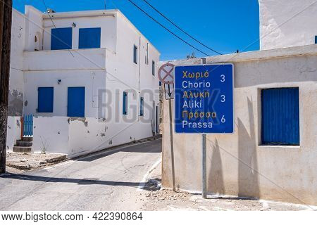 Greece, Kimolos Island. Information Road Signs, Traditional Whitewashed Buildings At Chora.