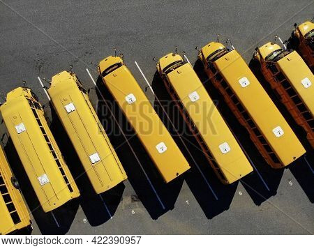 School Busses Lined Up In A Row At The Highschool