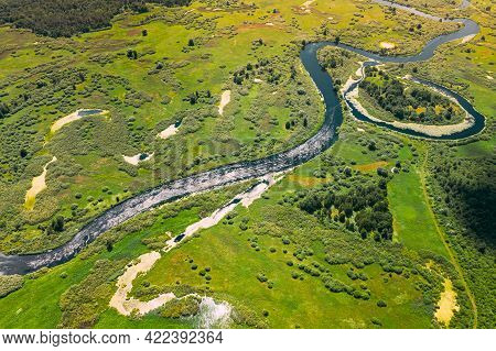 Aerial View Green Forest Woods And River Landscape In Sunny Spring Summer Day. Top View Of Beautiful