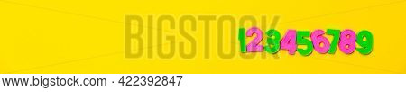 Numbers Set 1, 2, 3, 4, 5, 6, 7, 8, 9. Colorful Plastic Numerals Isolated On Yellow Background. Post