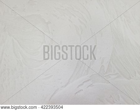 Close Up Of Beige Painted Wall With Stucco Swirl Pattern