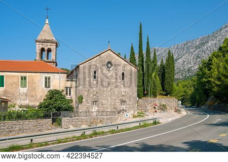 Small christian church near the road at sunny day in Makarska riviera, Croatia.