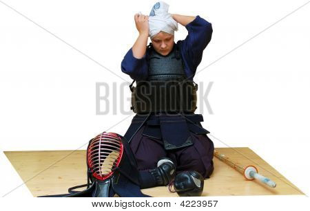 woman puts on kendo uniform. isolated on white poster