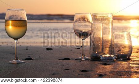 Candle Flame Lights In Glass, Romantic Beach Date By California Ocean Waves, Summer Sea Water. Candl