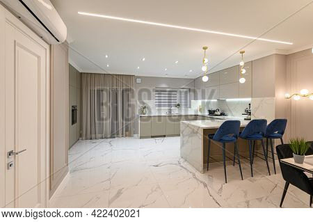 Luxury large modern white marble kitchen united with dining room
