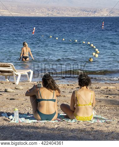 Eilat, Israel - May 24th, 2021: Two Young Women In Bathing Suits Suntanning On An Eilat, Israel, Bea