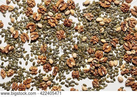 Dry Nuts Background. Nuts Pattern From Above. Different Types Of Nuts On A White Background