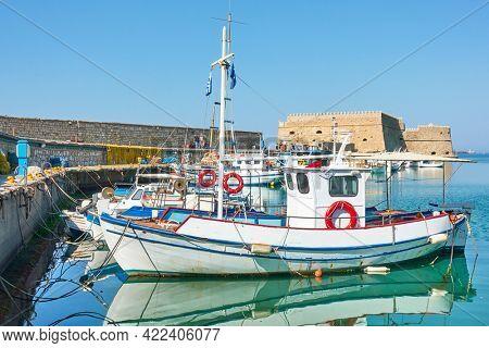 Heraklion in Greece.  Fishing boats in the venetian harbor near the old fortress, Crete Island