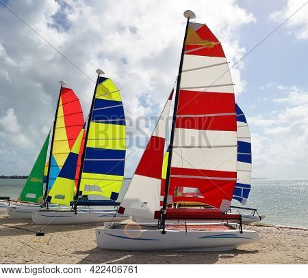 Catamaran Sailboats Resting In The Sand On A Key Biscayne,florida Beach.