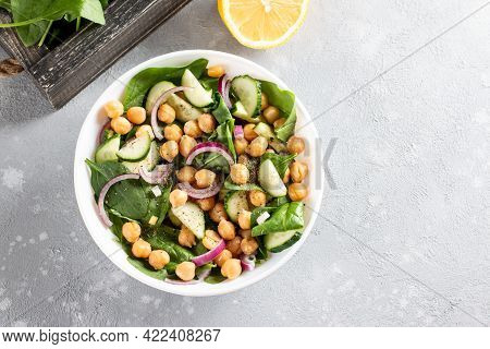 Salad Of Chickpeas, Spinach, Cucumbers, Onions And Greens In A Plate. Dietary Food. Vegan Salad. Top