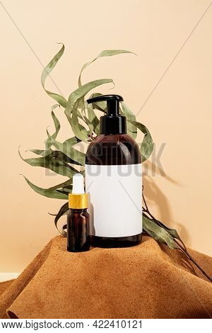 Brown Bottles Mockup For Natural Cosmetics, Spa Accessories On Brown Leather Podium, Cream Backgroun