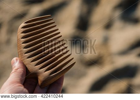 Handmade Wooden Comb For Scalp Massage And Hair Combing. Hair Care Concept.