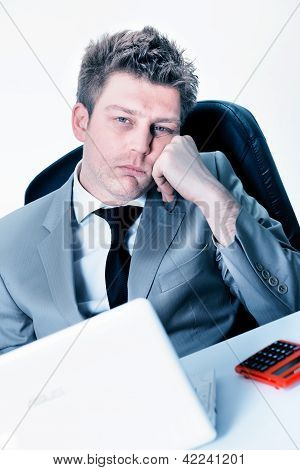 Tired Businessman At The Office