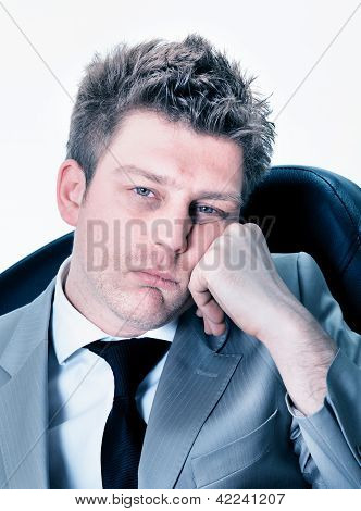 Portrait of tired businessman at the office poster