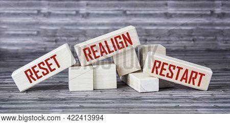 Reset, Realign, Restart Concept - Abstract Words Written On Wooden Blocks