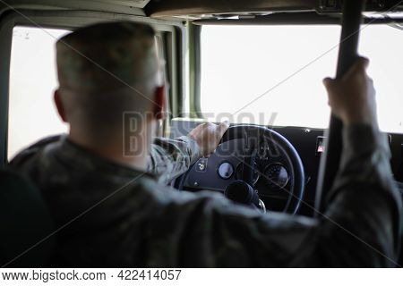 Smardan, Romania - May 11, 2021: Romanian Soldier Driving An Uro Vamtac Armored Vehicle.