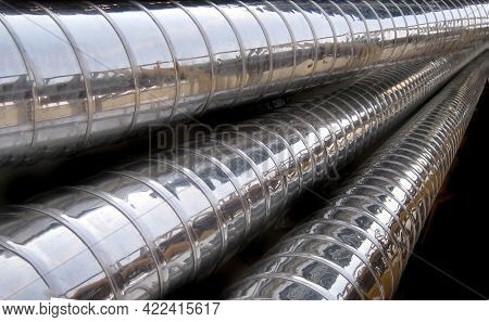 Three Stainless Steel Pipes In Diagonal Composition, Shiny Metal Pipes On A Black Background, Horizo