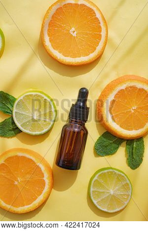 Cosmetic Oil And Citrus Fruits . Cosmetic Procedures. Healthy Skin. Skin Care. Citrus Oil. Yellow Ba