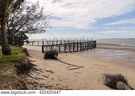 A Safe Netted Swimming Enclosure At The Beach At Low Tide, Also Showing Beach Erosion And Felled Tre