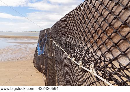 Close Up Of The Wall Forming A Netted Beach Swimming Enclosure