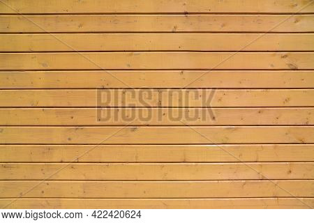 Texture Of An Edge Siding Made Of Painted In Beige Panels With Multiple Knots As A Background
