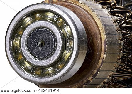Ball Bearing On The Motor Rotor. Copper Motor Winding. Isolated Background.