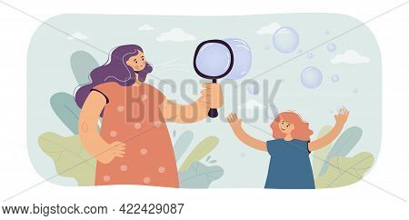Mother And Daughter Inflating Air Bubbles. Woman And Girl Playing Together, Happy Family Time Togeth
