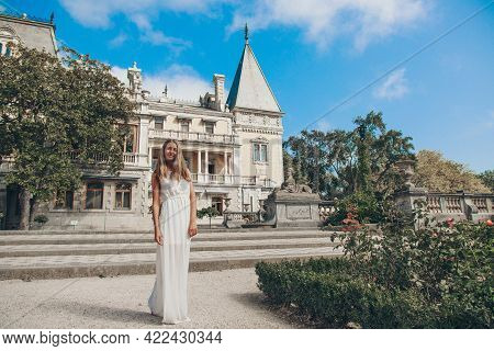 Young Beautiful Girl In Summer Dress. Travels Around The European City In The Summer. Cheerful, Smil