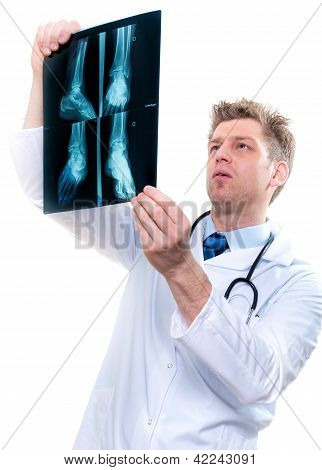 cheerful male doctor examining feet x-ray over white background poster