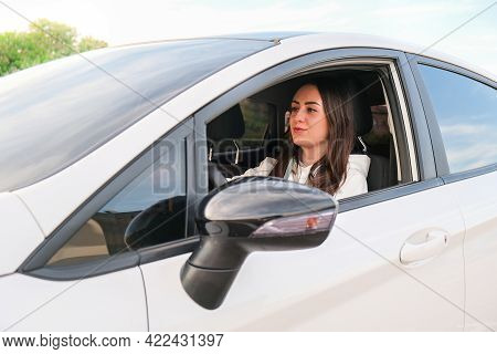 Young Happy Millennial Brunette Woman Driving Car. Young Attractive Woman In The Car. Woman Drive An