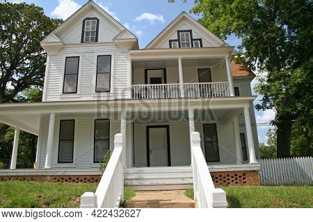 Historic Mansion With Sidewalk And Lawn Close Up