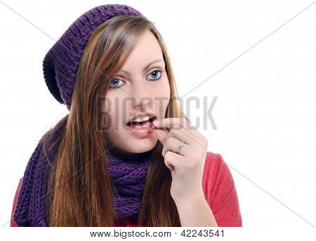 Beautiful Female Taking Tablet Against A White Background