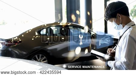 Asian Man Mechanic Inspection Writing Tablet. Car For Service Maintenance Insurance With Car Engine.