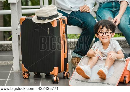 Father Mother And The Son Asian Hold Passport, Map To Trip Family Preparing For Traveling We Are Pos