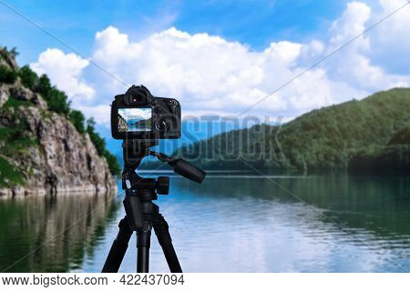 Taking Photo Of Beautiful River And Mountains With Camera Mounted On Tripod