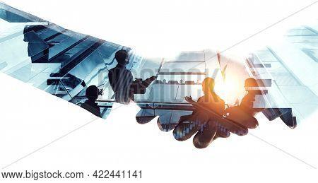 Partnership concept. Image of handshake . Mixed media
