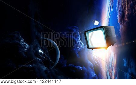 Retro TV flying in space . Mixed media