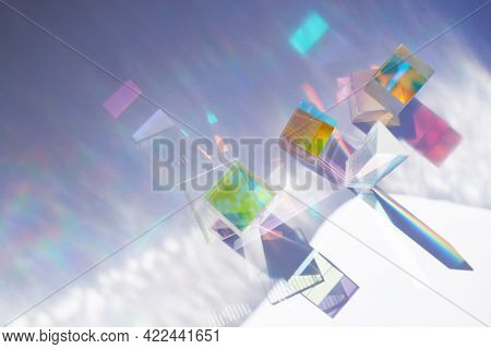 Abstract Background With Glass Geometric Figures Prisms With Light Diffraction Of Spectrum Colors An