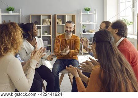 Happy Patients Applauding Mature Psychologist Or Therapist After Group Therapy Session