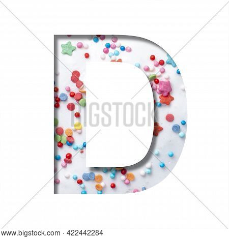 Sweet Glaze Font. The Letter D Cut Out Of Paper On The Background Of White Sweet Glaze With Colored