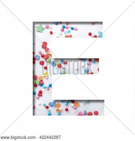 Sweet Glaze Font. The Letter E Cut Out Of Paper On The Background Of White Sweet Glaze With Colored